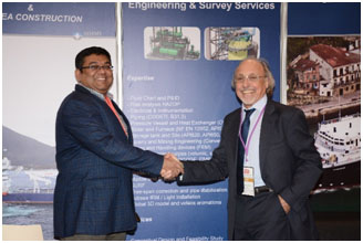 "Rajeev Kumar, COO of ADAMS, and Jean-Pierre Fontanille, CEO of Delta Forst Int'l, sealing the JV ""ADF"" at the GIF in Bahrain."